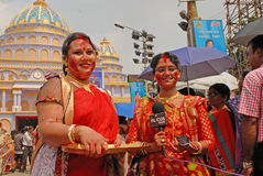 News Reporter. A woman news reporter during the vermilion play-it's a traditional ceremony on the final day of Durga Puja festival Royalty Free Stock Images