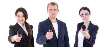 News reporters or journalists interviewing a person holding up t Stock Photography