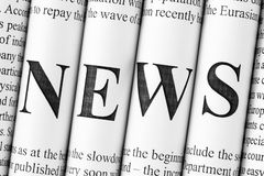 News. Stack of newspapers with small text and big letters forming together word NEWS Stock Photography