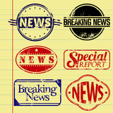 News stamps. News themed rubber stamps on a vector paper background Stock Photo