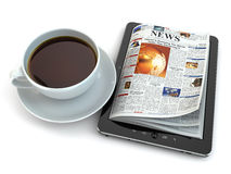 News on tablet pc with coffee cup. Royalty Free Stock Photos