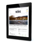 News on a tablet Stock Photo