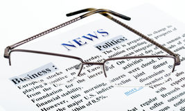 News text. Glasses is on the news text as a background Stock Images