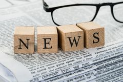 News text on wooden blocks with eyeglasses Stock Photos