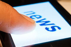 News on touch. Closeup of news on touch screen Royalty Free Stock Images