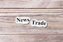 News trade of the word on paper. concept. Words of News trade on a wooden background.  royalty free stock images