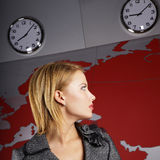 News tv reporter looking at the time Royalty Free Stock Image
