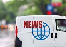 News van on city street. With green background Royalty Free Stock Photography