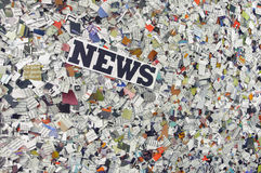 News. The word News made from newspaper confetti royalty free stock images
