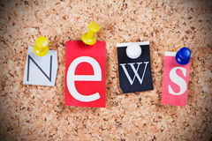 News Word. Message News made of newspaper letters, hanged at cork board with thumbtacks Royalty Free Stock Images