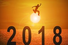 2018 news year and concepts for business and target. Silhouette of young man jumping over the numbers 2018 years with beautiful sunset at the sea, concepts of vector illustration