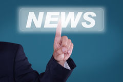 News. Young man pressing a button News Royalty Free Stock Photography