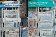 Newsagent`s shop. Bracciano, Italy - July 31, 2018: Newsagent`s shop exterior, newsstands full of foreign daily newspapers stock photo
