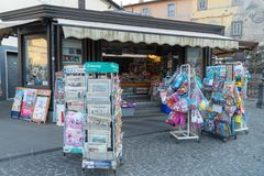 Newsagent`s shop. Bracciano, Italy - July 31, 2018: Newsagent`s shop exterior, newsstands full of foreign daily newspapers royalty free stock photo