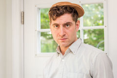 Newsboy Fashion Man. Young handsome curly haired man wearing newsboy hat Royalty Free Stock Photos