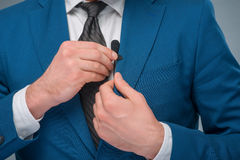 Newscaster adjusting the microphone Royalty Free Stock Image