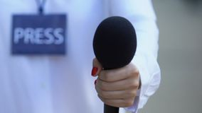 Newscaster with press pass holding microphone, interviewing celebrity, reportage. Stock footage stock video