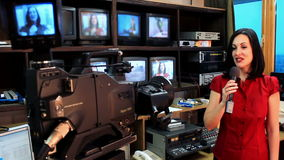 Newscaster in a television studio stock footage