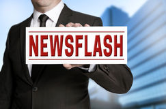 Newsflash sign is held by businessman Stock Images