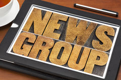 Newsgroup word typography on tablet Stock Image