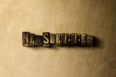 NEWSLETTER - close-up of grungy vintage typeset word on metal backdrop Royalty Free Stock Images