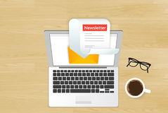 Newsletter. Illustration with laptop placed on realistic wooden background. Top view with cup of coffee and eyeglasses Stock Photography