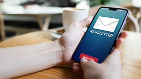Newsletter subscription button on mobile phone screen. Business marketing concept. royalty free stock photos