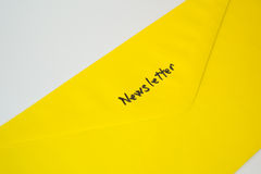 Newsletter / Subscription yellow envelope. Newsletter yellow envelope , letter on white background stock photography