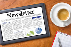 Newsletter. Tablet on a desk - Newsletter Stock Photos