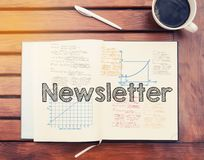 Newsletter : text inside notebook on table with coffee Royalty Free Stock Photography