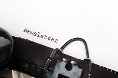 Newsletter text on retro typewriter. Close up view - Newsletter - written on an old typewriter Royalty Free Stock Images