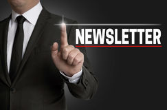 Newsletter touchscreen is operated by businessman Royalty Free Stock Images