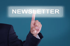 Newsletter. Young man presses button newsletter Stock Images