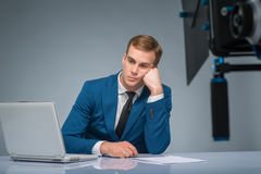 Newsman looking bored and weary Royalty Free Stock Image