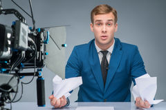 Newsman looks stressed out Stock Photo