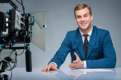Newsman during shooting process Royalty Free Stock Photography