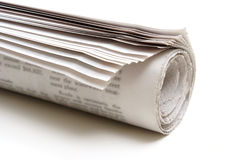 Newspaper. A rolled up newspaper on a white background Royalty Free Stock Photos