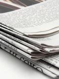 Newspaper. News paper close up on a white back ground Royalty Free Stock Photos