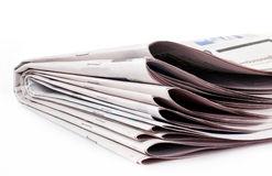 Newspaper. A stack of newspaper isolated on white background