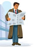 Newspaper. A businessman standing and reading a newspaper Royalty Free Stock Photos