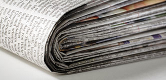 Newspaper. Folded newspaper lying on a desk Stock Photography