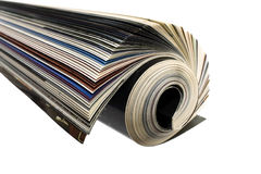 Newspaper. Rolled up white background isolate Royalty Free Stock Images