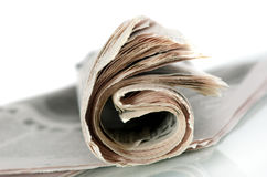 The newspaper. The thick curtailed newspaper on a white background Stock Photos