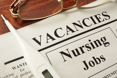 Newspaper with ads nursing jobs vacancy. Occupation concept stock photo