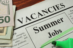 Newspaper with ads summer jobs vacancy. Occupation concept royalty free stock image