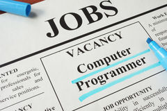 Newspaper with ads for vacancy Computer Programmer. stock images