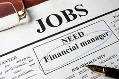 Newspaper with ads for vacancy financial manager. royalty free stock image