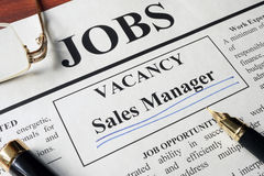 Newspaper with ads for vacancy sales manager. Employment concept royalty free stock images