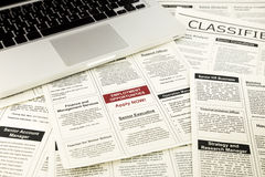 Newspaper with advertisements and classifieds ads. For vacancy, job search and apply now stock photography