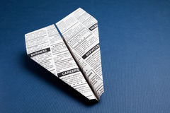 Newspaper Airplane. Fake Newspaper,  Airplane, Classified Ad, business concept Royalty Free Stock Photo